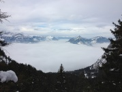 first peek of Alps above the fog